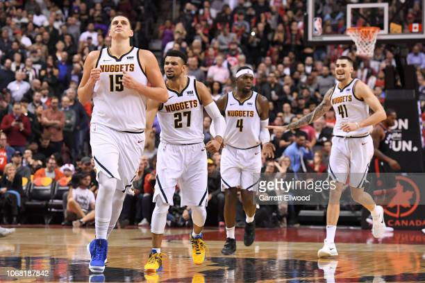 Nikola Jokic and Jamal Murray of the Denver Nuggets react to a play during the game against the Toronto Raptors on December 3 2018 at Scotiabank...