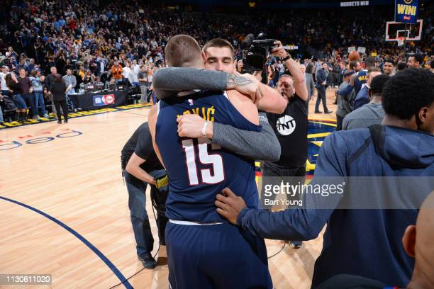 Nikola Jokic and Juan Hernangomez of the Denver Nuggets hug after the game against the Dallas Mavericks on March 14 2019 at the Pepsi Center in...