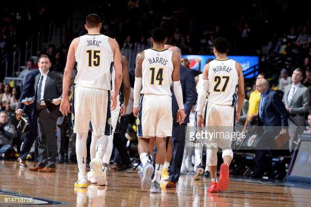 Nikola Jokic Gary Harris and Jamal Murray of the Denver Nuggets walk to the sideline during a time out during the game against the Charlotte Hornets...