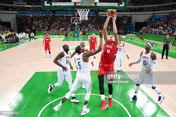 Nikola Jokic of Serbia shoots the ball against the USA Basketball Men's National Team on Day 7 of the Rio 2016 Olympic Games at Carioca Arena 1 on...