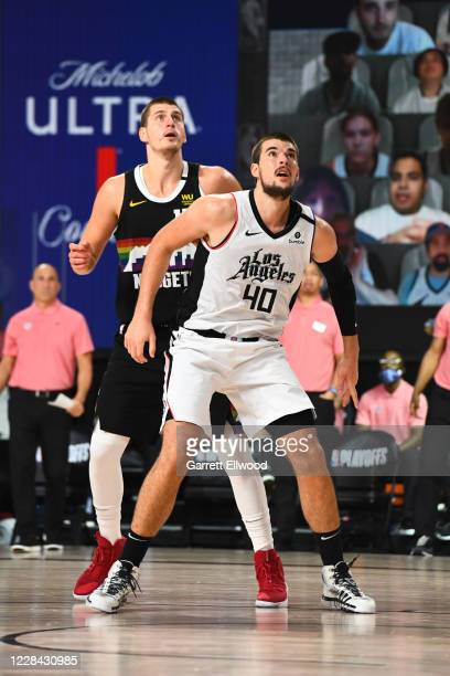 Nikola Jokic of the Denver Nuggets and Ivica Zubac of the LA Clippers fight for the rebound during Round Two, Game Four of the Western Conference...