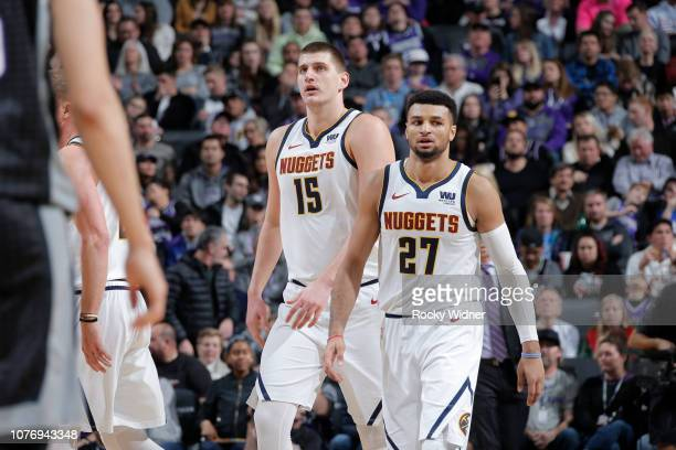 Nikola Jokic of the Denver Nuggets and Jamal Murray of the Denver Nuggets looks on during the game against the Sacramento Kings on January 3 2019 at...