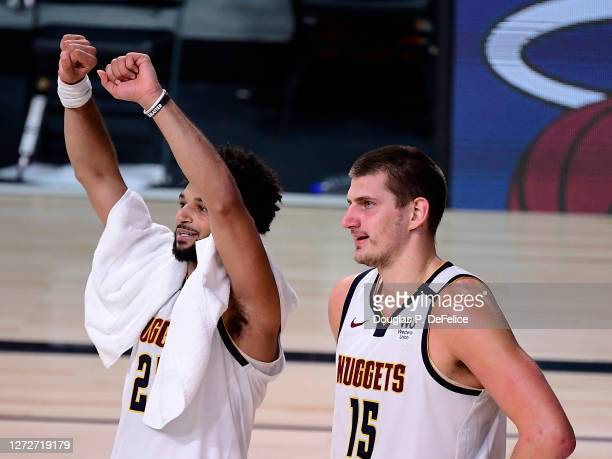 Nikola Jokic of the Denver Nuggets and Jamal Murray of the Denver Nuggets celebrate their win over LA Clippers in Game Seven of the Western...