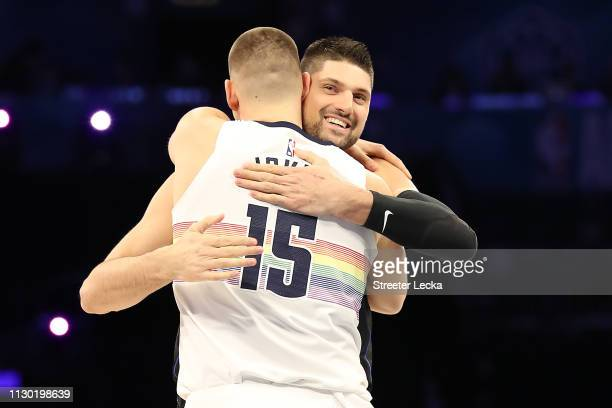Nikola Jokic of the Denver Nuggets and Nikola Vučević of the Orlando Magic show camaraderie during the Taco Bell Skills Challenge as part of the 2019...