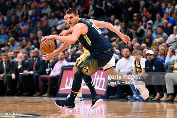 Nikola Jokic of the Denver Nuggets and Zaza Pachulia of the Golden State Warriors battle for a loose ball at Pepsi Center on February 3 2018 in...