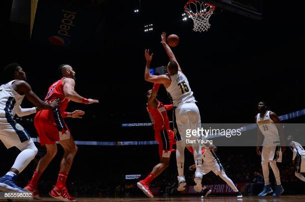 Nikola Jokic of the Denver Nuggets attempts to block a shot against the Washington Wizards on October 23 2017 at the Pepsi Center in Denver Colorado...