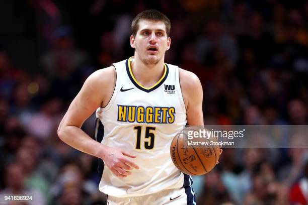 Nikola Jokic of the Denver Nuggets brings the ball down the court against the Indiana Pacers at the Pepsi Center on April 3 2018 in Denver Colorado...