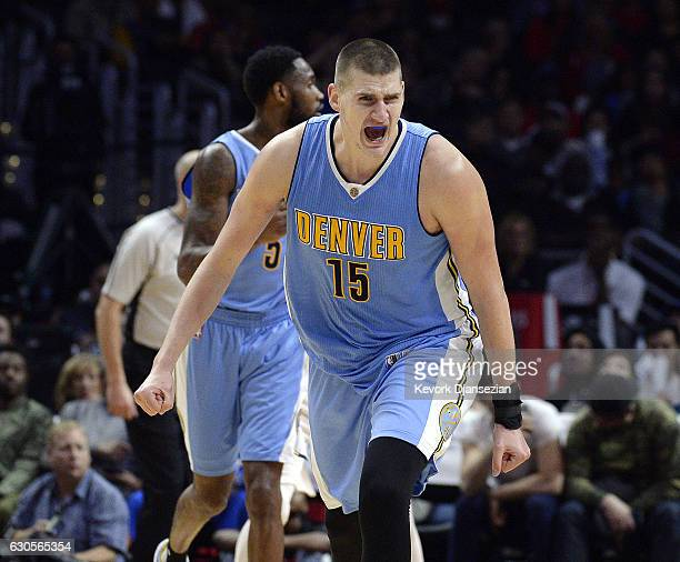 Nikola Jokic of the Denver Nuggets celebrates after hitting a threepoint basket against the Los Angeles Clippers in the closing minutes of the...