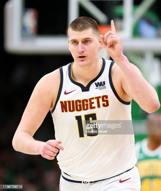 Nikola Jokic of the Denver Nuggets celebrates after scoring against the Boston Celtics during the second half at TD Garden on March 18, 2019 in...