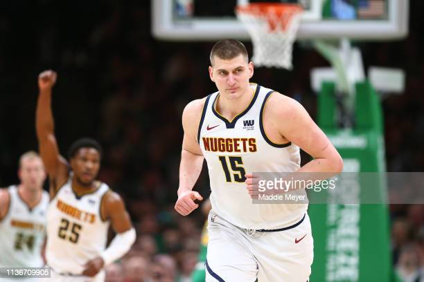 Nikola Jokic of the Denver Nuggets celebrates after scoring against the Boston Celtics during the second half at TD Garden on March 18 2019 in Boston...
