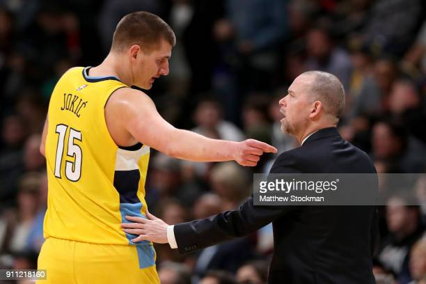 Nikola Jokic of the Denver Nuggets confers with head coach Michael Malone while playing the Dallas Mavericks at the Pepsi Center on January 27 2018...