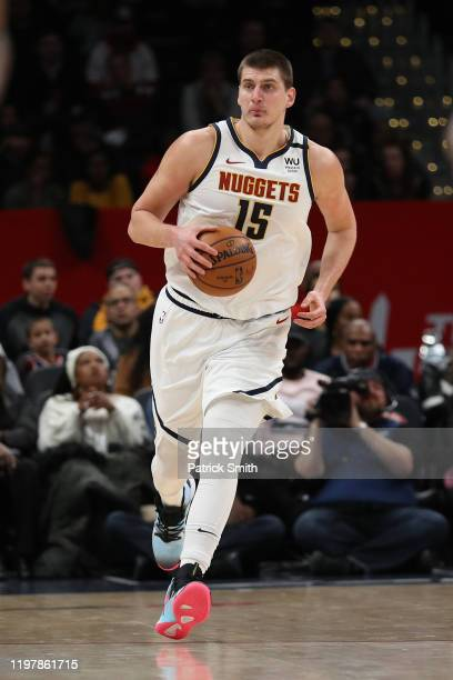 Nikola Jokic of the Denver Nuggets dribbles the ball against the Washington Wizards during the first half at Capital One Arena on January 04, 2020 in...