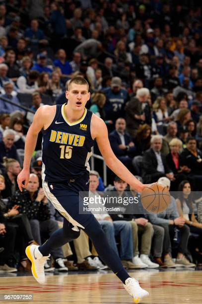 Nikola Jokic of the Denver Nuggets dribbles the ball against the Minnesota Timberwolves during the game on April 11 2018 at the Target Center in...