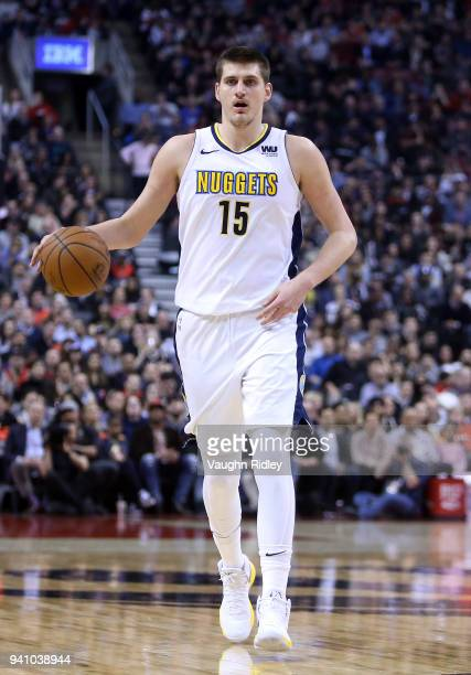 Nikola Jokic of the Denver Nuggets dribbles the ball during the first half of an NBA game against the Toronto Raptors at Air Canada Centre on March...