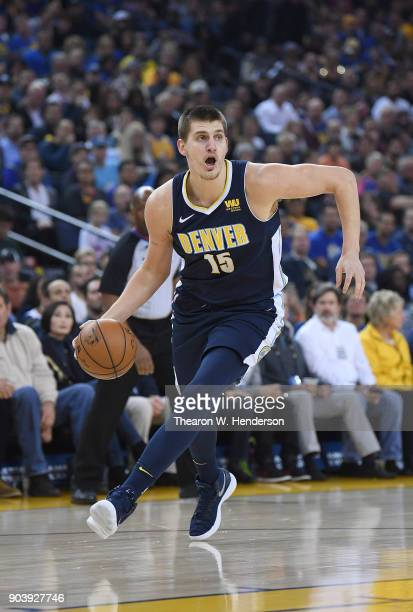 Nikola Jokic of the Denver Nuggets dribbles the ball up court against the Golden State Warriors during an NBA Basketballl game at ORACLE Arena on...