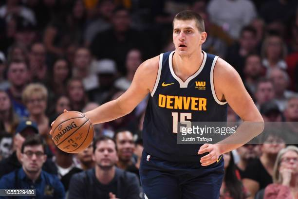 Nikola Jokic of the Denver Nuggets dribbles the ball up the court against the New Orleans Pelicans at Pepsi Center on October 29 2018 in Denver...