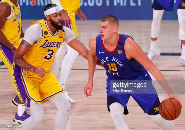 Nikola Jokic of the Denver Nuggets drives against Anthony Davis of the Los Angeles Lakers during the third quarter in Game One of the Western...