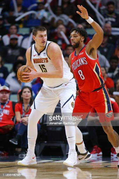 Nikola Jokic of the Denver Nuggets drives against Jahlil Okafor of the New Orleans Pelicans during a game at the Smoothie King Center on October 31...