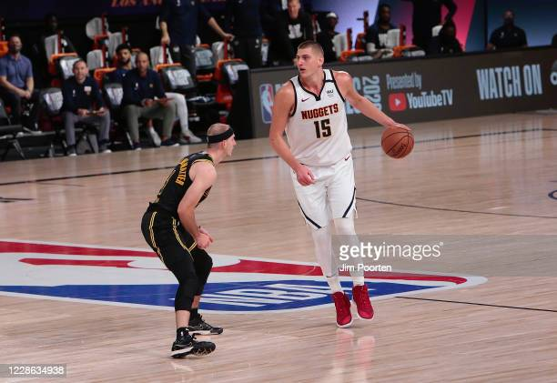 Nikola Jokic of the Denver Nuggets drives in the game against Alex Caruso of the Los Angeles Lakers in Game two of the Western Conference Finals of...