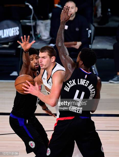 Nikola Jokic of the Denver Nuggets drives the ball against JaMychal Green of the LA Clippers and Paul George of the LA Clippers during the second...