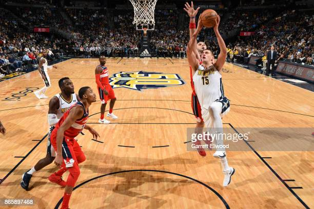 Nikola Jokic of the Denver Nuggets drives to the basket against the Washington Wizards on October 23 2017 at the Pepsi Center in Denver Colorado NOTE...