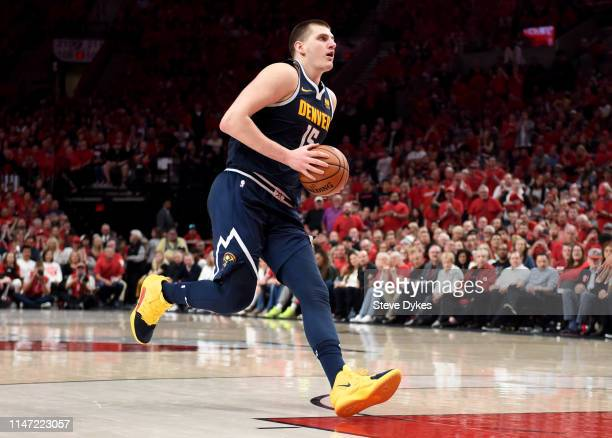 Nikola Jokic of the Denver Nuggets drives to the basket during the second half of game four of the Western Conference Semifinals against the Portland...