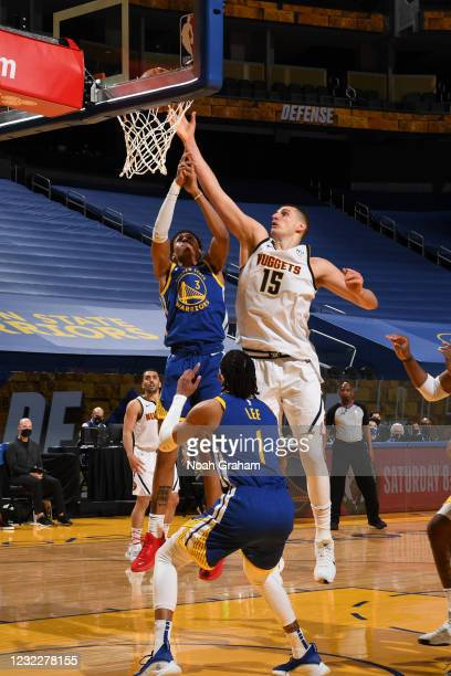Nikola Jokic of the Denver Nuggets drives to the basket during the game against the Golden State Warriors on April 12, 2021 at Chase Center in San...