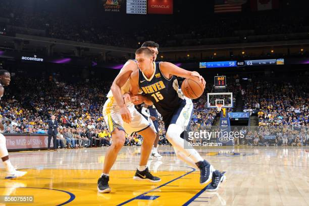 Nikola Jokic of the Denver Nuggets drives to the basket during the game against the Golden State Warriors during a preseason game on September 30...