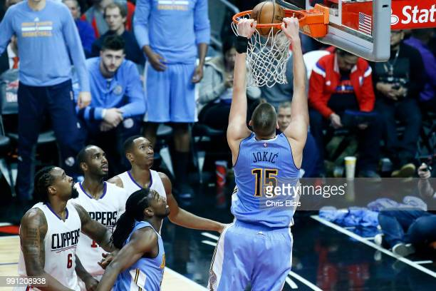 Nikola Jokic of the Denver Nuggets dunks the ball against the LA Clippers on December 26 2016 at the STAPLES Center in Los Angeles California NOTE TO...