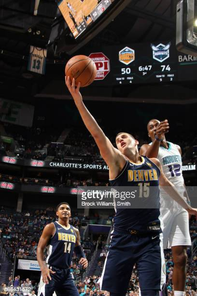 Nikola Jokic of the Denver Nuggets goes for a lay up against the Charlotte Hornets on October 25 2017 at Spectrum Center in Charlotte North Carolina...