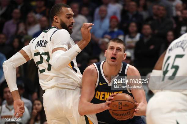 Nikola Jokic of the Denver Nuggets goes to the basket against Rudy Gobert of the Utah Jazz in the first quarter at the Pepsi Center on January 30,...
