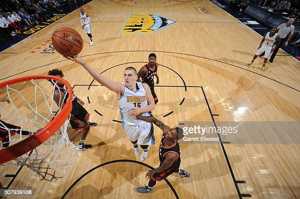 Nikola Jokic of the Denver Nuggets goes to the basket against the Toronto Raptors on February 1 2016 at the Pepsi Center in Denver Colorado NOTE TO...