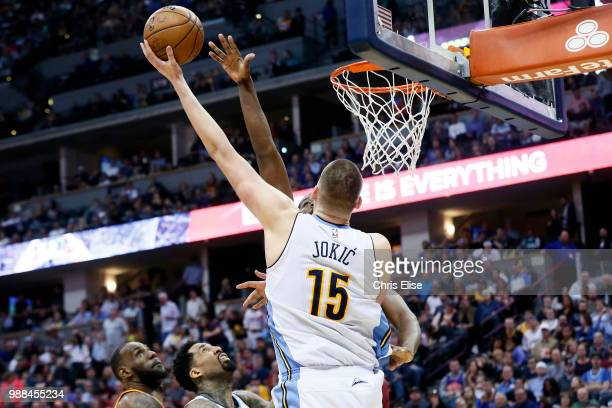 Nikola Jokic of the Denver Nuggets goes to the basket against the Cleveland Cavaliers on March 22 2017 at the Pepsi Center in Denver Colorado NOTE TO...
