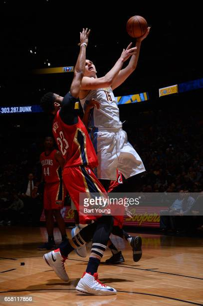 Nikola Jokic of the Denver Nuggets goes up for a lay up against the New Orleans Pelicans on March 26 2017 at the Pepsi Center in Denver Colorado NOTE...