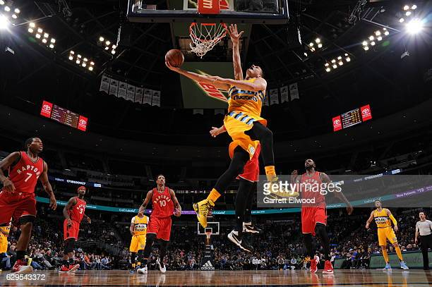 Nikola Jokic of the Denver Nuggets goes up for a lay up during a game against the Toronto Raptors on November 18 2016 at the Pepsi Center in Denver...