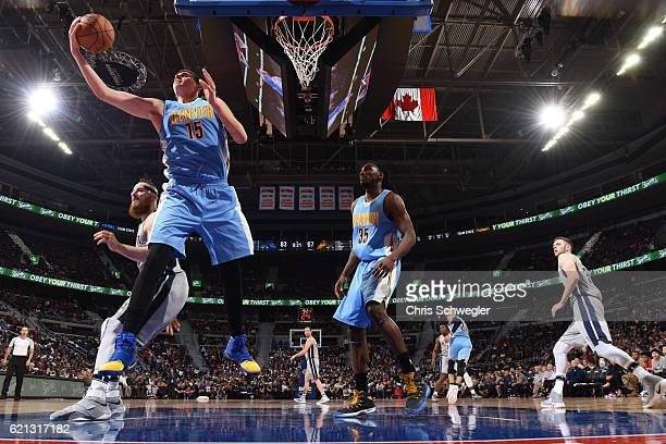 Nikola Jokic of the Denver Nuggets grabs the rebound against the Detroit Pistons on November 5 2016 at The Palace of Auburn Hills in Auburn Hills...