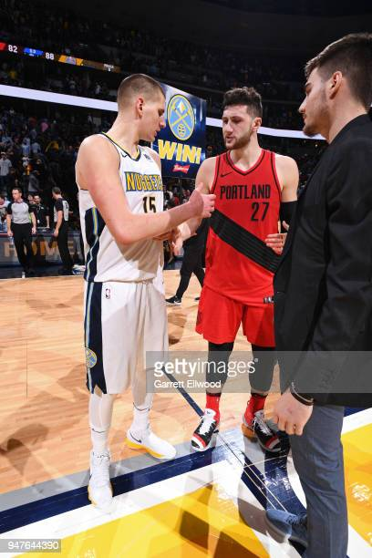 Nikola Jokic of the Denver Nuggets greets Jusuf Nurkic of the Portland Trailblazers during the game between the two teams on APRIL 9 2018 at the...