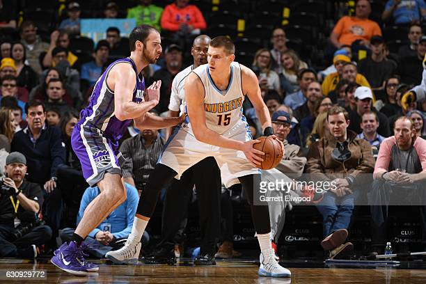 Nikola Jokic of the Denver Nuggets handles the ball against Kosta Koufos of the Sacramento Kings during the game on January 3 2017 at the Pepsi...