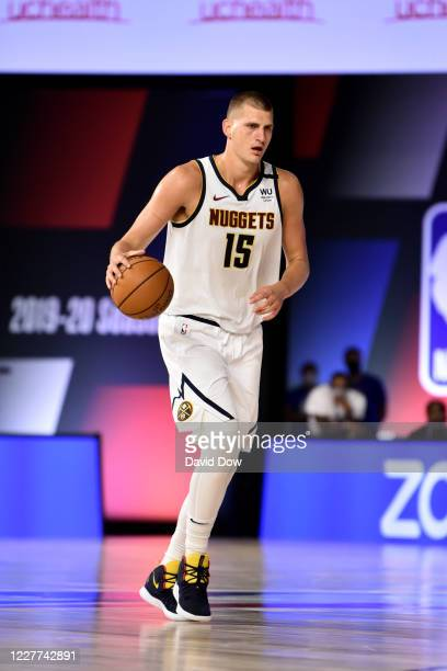 Nikola Jokic of the Denver Nuggets handles the ball against the Washington Wizards during a scrimmage on July 22, 2020 at The Arena at ESPN Wide...