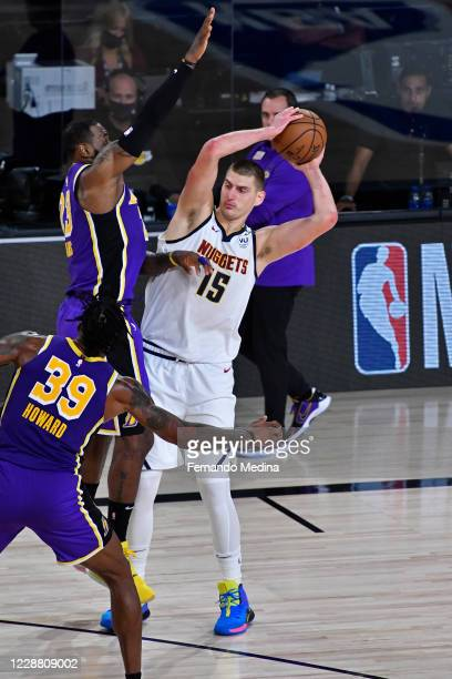 Nikola Jokic of the Denver Nuggets handles the ball against the Los Angeles Lakers during Game Five of the Western Conference Finals of the NBA...