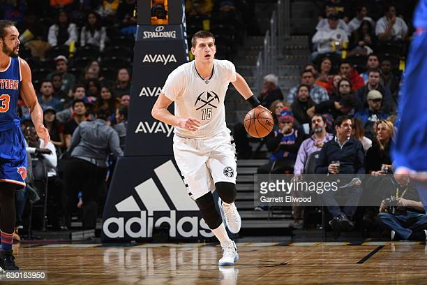 Nikola Jokic of the Denver Nuggets handles the ball against the New York Knicks on December 17 2016 at the Pepsi Center in Denver Colorado NOTE TO...