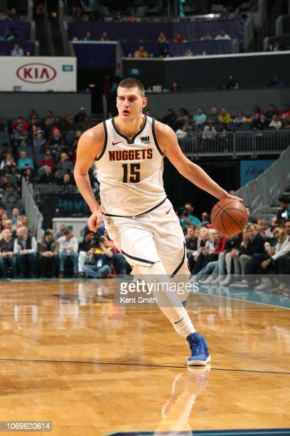 Nikola Jokic of the Denver Nuggets handles the ball against the Charlotte Hornets on December 7 2018 at the Spectrum Center in Charlotte North...