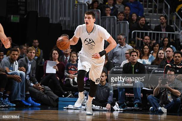 Nikola Jokic of the Denver Nuggets handles the ball against the Dallas Mavericks on December 19 2016 at the Pepsi Center in Denver Colorado NOTE TO...