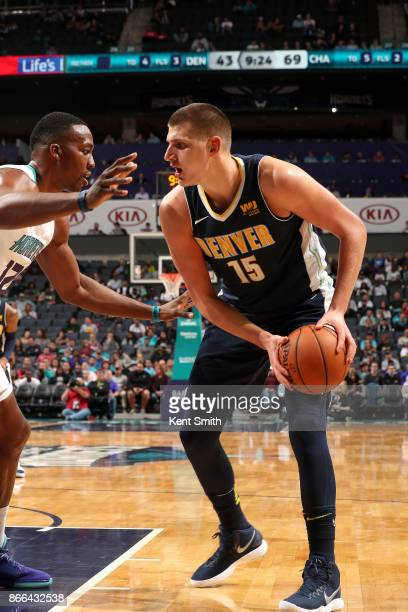 Nikola Jokic of the Denver Nuggets handles the ball against the Charlotte Hornets on October 25 2017 at Spectrum Center in Charlotte North Carolina...