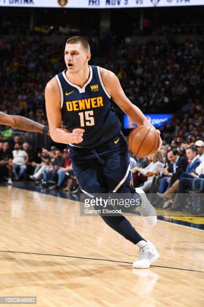Nikola Jokic of the Denver Nuggets handles the ball against the Phoenix Suns on October 20 2018 at the Pepsi Center in Denver Colorado NOTE TO USER...