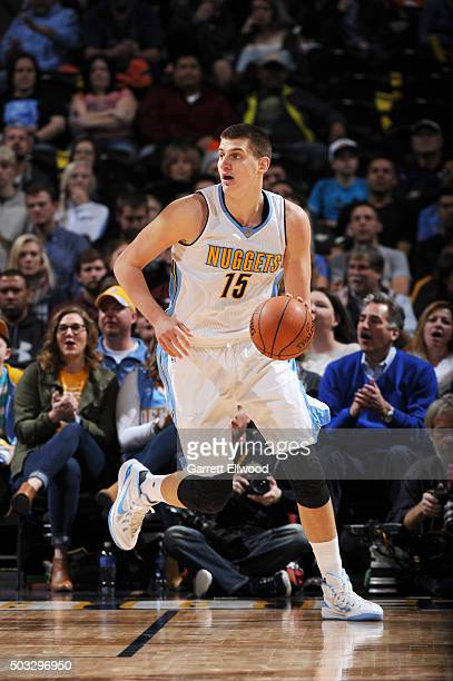 Nikola Jokic of the Denver Nuggets handles the ball during the game against the Portland Trail Blazers on January 3 2016 at the Pepsi Center in...
