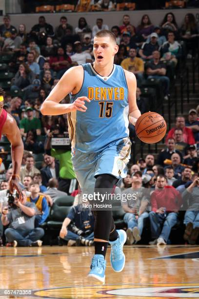 Nikola Jokic of the Denver Nuggets handles the ball during the game against the Indiana Pacers on March 24 2017 at Bankers Life Fieldhouse in...