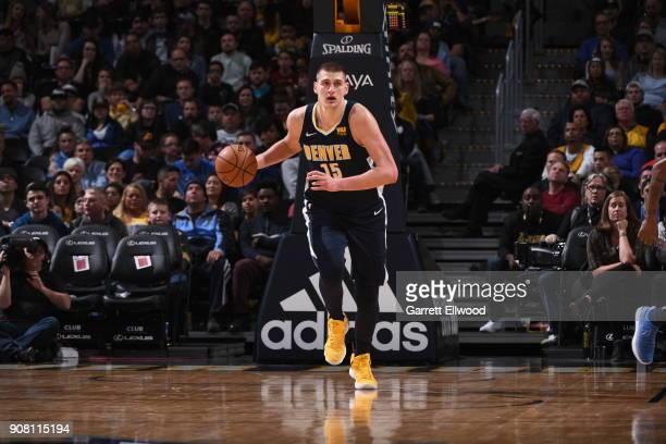 Nikola Jokic of the Denver Nuggets handles the ball during the game against the Phoenix Suns on January 19 2018 at the Pepsi Center in Denver...