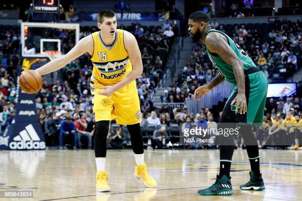 Nikola Jokic of the Denver Nuggets handles the ball during the game against the Boston Celtics on March 10 2017 at Pepsi Center in Denver Colorado...