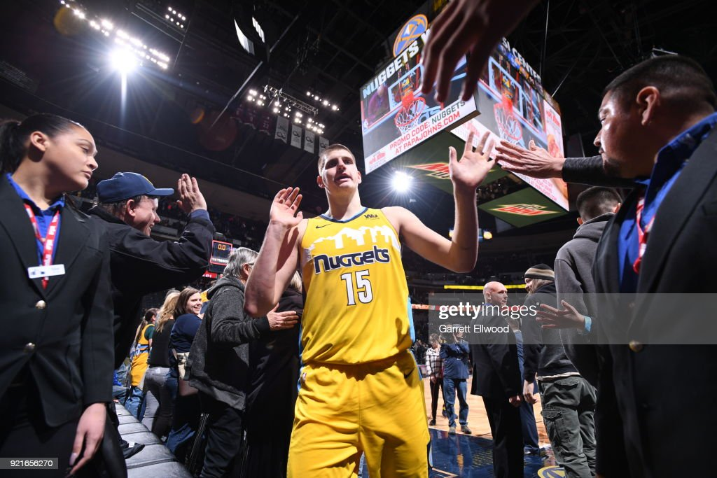 Nikola Jokic #15 of the Denver Nuggets high fives fans after the game against the Dallas Mavericks on January 27, 2018 at the Pepsi Center in Denver, Colorado.